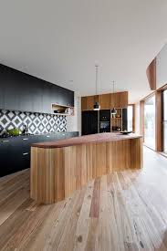 cute vinyl flooring that looks like ceramic tile with irregular kitchen island next to unique kitchen island and cement tiles