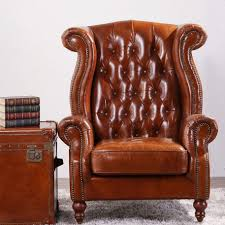 vintage wing high back armchair tan leather gci outdoor chair queen anne second hand chesterfield suites laura furniture decorative pillows arm pads pottery
