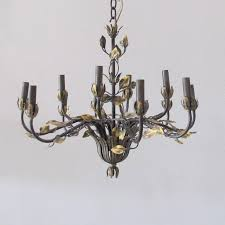 this iron vintage chandelier has been newly hand painted by our talented custom finisher