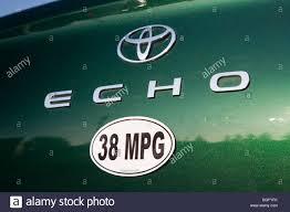 Close up of a 38 miles per gallon fuel efficiency bumper sticker ...