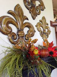 tuscan style wall shelf decorated for fall
