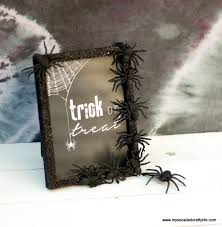 today i am going to share a super easy and quick diy with you my spider covered glitter frame you can get most of what you need at the
