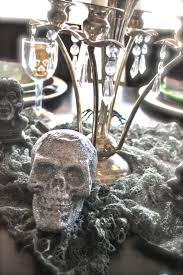A spooky #Halloween table setting with a candelabra from #Goodwill. #Decor #
