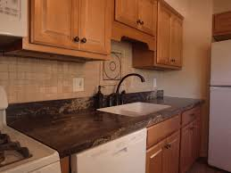animated image showing pictures of kitchen cabinets with and without led under cabinet fixtures