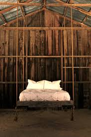 Wooden Wall Decoration In Traditional Small Bedroom Design With Suspended  Bed In Black Color Pink Bedcover ...