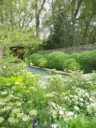 Formal And Informal Landscape Design Green And White Is Soothing And The Combination Of Formal