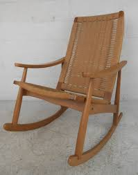 intricately woven rope cord rocker in the style of hans wegner stamped