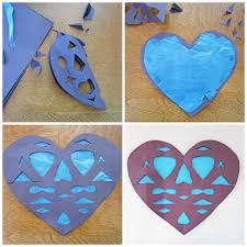 teach your kids how to make these faux stained glass paper hearts for decorating your