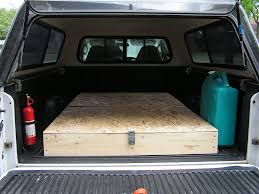 homemade truck bed storage and sleeping platform for camping