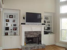 where to put components with wall mount tv over fireplace