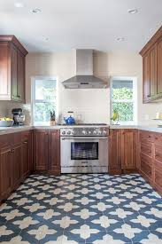 kitchen blue and white tile floor with a pattern to stand out
