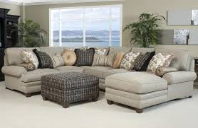 furniture gray fabric sofa with colorful cushions plus short brown wooden legs also gray square