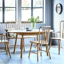 extending round dining table and chairs extending oak round table dining and 6 chairs canterbury