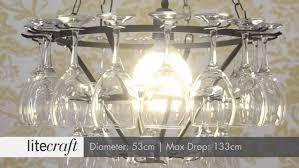 small black chandelier drum chandelier bubble wine glasses wine bottle light fixture