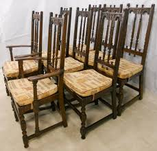 set of eight ercol high back dark elm dining chairs from old colonial range
