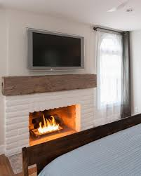 white brick fireplace with rustic mantel
