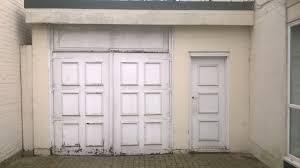 old garage door and personnel door