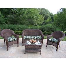 oakland living resin wicker 4 piece wicker frame patio conversation set with black fl cushions