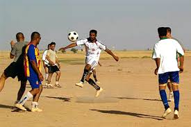 u s department of defense photo essay  a mahus village soccer player kicks the ball and scores against the coalition team during a
