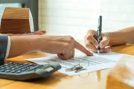 Buyers Are Signing A Home Purchase Agreement From A Broker. Stock ...