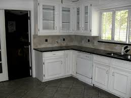 off white cabinets dark floors. kitchen with dark floors and white cabinets cabinet off