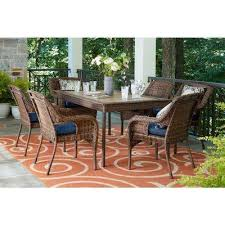 cambridge brown 7 piece wicker outdoor dining set with blue cushions