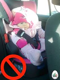 child into their car seat correctly