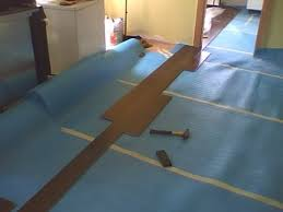 laying out hardwood flooring multiple rooms