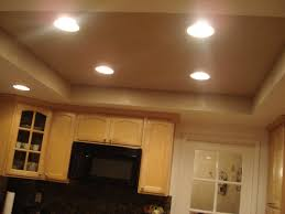 double white pendant lamp dining room recessed lighting storage under shiny white marble granite countertop brown