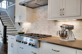 White Cabinets Backsplash Brown Kitchen Cabinets With White Subway Tile Quicuacom