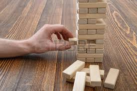 Wooden Bricks Game Closeup Hands Of Man Pulls Out Wooden Bricks Removing Blocks 64