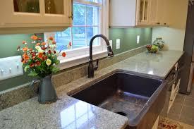 quartz countertop with copper farm sink transitional kitchen