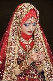 makeup look regal red muslim bridal dress with embroidered stones