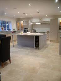 This popular low cost tumbled travertine tile has an authentic rustic  feeling which would suit a more traditional property or a barn conversion.