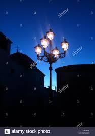 Street Lights In Villages Ornamental Street Light Dusk Village Spain Stock Photo