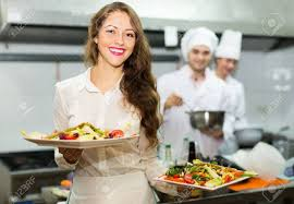 stock photo team of chefs and young beautiful waiter at restaurant kitchen36 kitchen