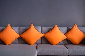 orange pillow on sofa interior