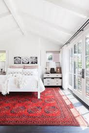 E White Bedroom With Bright Red Rug Black Accents Pantone Flame