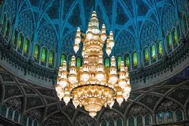 a chandelier hanging underneath a dome
