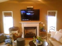 mounting a tv above a gas fireplace mounting above fireplace hiding wires hanging mounting flat screen
