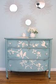 blue bird dresser transformation using chalk to draw design on drawer faces then paint over
