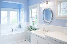 View in gallery Gorgeous bathroom in blue and white with round mirror above  the sink