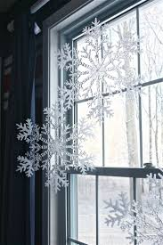 Plastic snowflakes from Dollar Tree hung from curtain rod with fishing wire  - @Stephanie Close