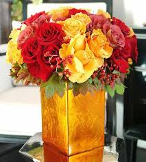 red and yellow floral arrangements are warm and attractive centerpiece ideas