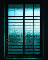 closed black metal framed frosted glass windowpane free stock photo