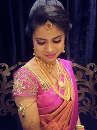 traditional southern indian bride wearing bridal silk saree and jewellery reception look makeup and