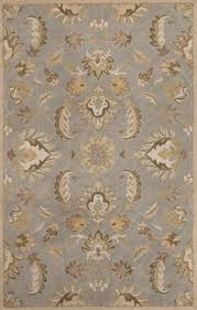 100 wool pile hand tufted cotton canvas backing use of rug pad recommended for this item spot clean wool fibers are e to shedding
