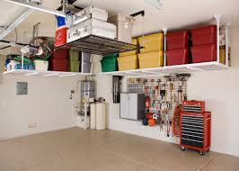 maximizing small spaces garage design using overhead storage shelves wall mounted gray metal cabinet pegboard hooks for tools and floor tiles