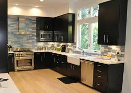 beige laminate floor with black wooden cabinet using mosaic backsplashes for contemporary kitchen plan and decor