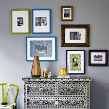 frames for living room. living room with grey walls and colourful photo frames for
